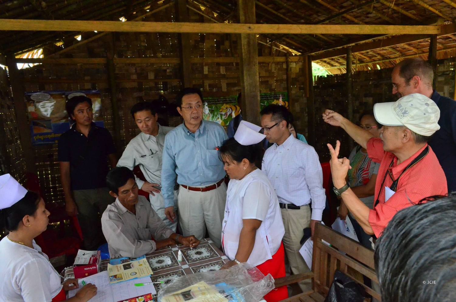 Diet members visit a malaria project funded by JICA